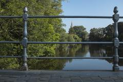 Stock Photo of a golden dawn on minnewater in bruges