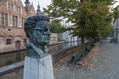 bust of frank van acker on steenhouwersdijk, bruges - stock photo