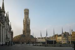early morning on grote markt in bruges - stock photo