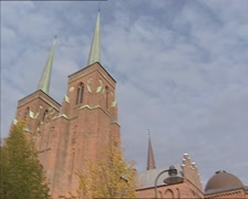 ROSKILDE CATHEDRAL- two towers flanking the west front  + tilt down south side Stock Footage