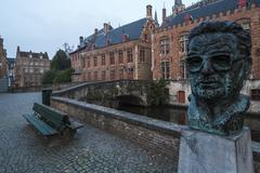 bust of frank van acker on steenhouwersdijk, bruges - stock photo