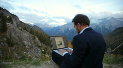 Architect working on project in the mountain with pc Stock Footage