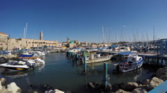 Port of Acre, Israel. with boats and the old city in the background. Stock Footage