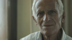 Confused and thoughtful old man portrait: mental illness, discomfort, disease Stock Footage
