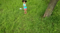 Top view of little girl playing with racket and shuttlecock Stock Footage