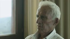old lonely man: sadness and fear in a aged man portrait - stock footage