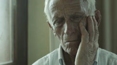 Sad old man sitting alone: sadness, loneliness, thoughts, thoughtful, depression Stock Footage