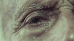 Old man sitting lonely near window: eye close-up, wrinkles and signs of aging Stock Footage