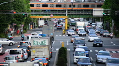 Time Lapse of Traffic on Busy Boulevard from Above - Tokyo Japan Stock Footage