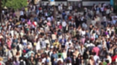 Blurred footage of pedestrians crossing the busiest crosswalk in the world Stock Footage