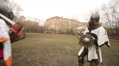 Two warriors in costumes fight at Russia-Orda XI-XV centuries Stock Footage