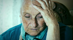 Anxious and distressed old woman Stock Footage