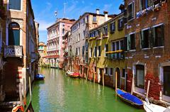 a picturesque secondary canal in venice, italy - stock photo