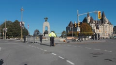 Police officers moving metal barriers, war memorial, ws Stock Footage