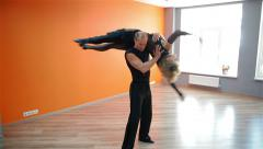 A pair of professional dancers trained in dance studio - stock footage