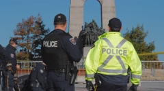 Police Officers by war memorial, Ottawa, Close-Up Stock Footage