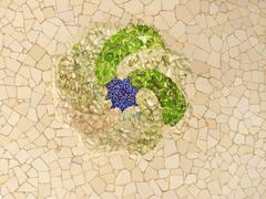 ceiling with mosaic sun of park guell - stock photo