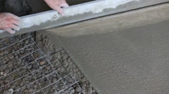 Hand of worker making screed of concrete floor in new apartments Stock Footage