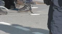 Police Officers by war memorial, Ottawa, metal detectors Stock Footage