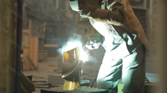 Gas welding, Portrait of a welder with protective equipment welding  Stock Footage