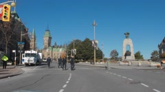Police Officers by war memorial and parliament hill, Ottawa Stock Footage