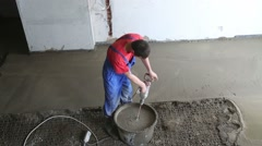Above view of worker preparing concrete grout for floor Stock Footage