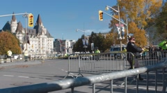 Police Officers by war memorial, Ottawa, placing police tape Stock Footage