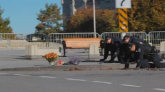 Police Sweeping area on Hands and Knees Stock Footage