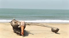 Boat on a beach - stock footage