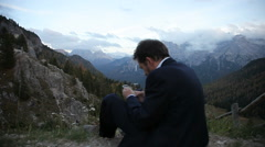 Man taking picture of beautiful mountain landscape Stock Footage