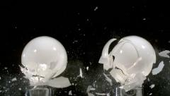 Lightbulbs hit by slingshot in super slow motion. Shot with Phantom camera at Stock Footage