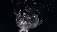 Lightbulb hit by slingshot in super slow motion. Shot with Phantom camera at - stock footage