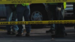 Police Tape with Officers in Background - stock footage