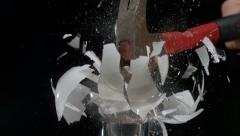 Smashing a lightbulb with hammer,  shot with Phantom camera at 6900 frames per - stock footage