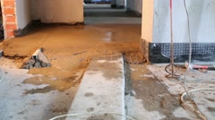 Poured concrete floor and tools in unfinished apartment Stock Footage