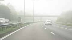 POV driving on a foggy motorway Stock Footage