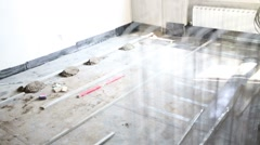 Screed for pouring cement floor and grid in unfinished apartment Stock Footage