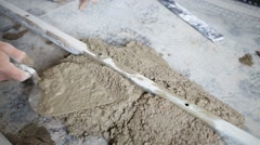 Hand of worker putting concrete solution for pouring floor Stock Footage
