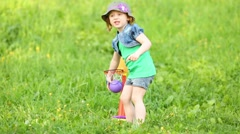 Little pretty girl plays mini basketball at green meadow Stock Footage