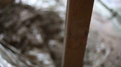 Gloved hands prepare door frame for installing door Stock Footage