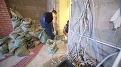 Two men prepare doorway to door installation. Stock Footage