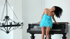 Young beautiful brunette dance near black grand piano. Stock Footage