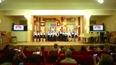 Pupils sing the song standing on stage during celebration Stock Footage