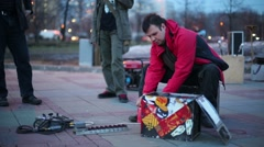 Man prepares apparatus for lighting gas during fire show. Stock Footage