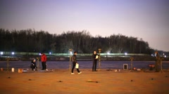 People prepare area to perform fire show in the evening. Stock Footage