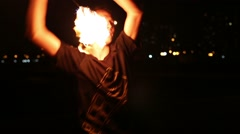 Young man juggles burning pois during fire show on open air Stock Footage