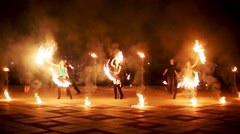 Group of firedancers dance, boy jumps making fireball. Stock Footage