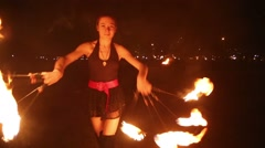 Young girl dances with burning torches made in shape of fans Stock Footage