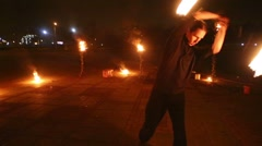 Stock Video Footage of Boy dances juggling burning pois at evening fire show.