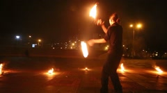 Boy dances and juggles burning pois at evening fire show. Stock Footage